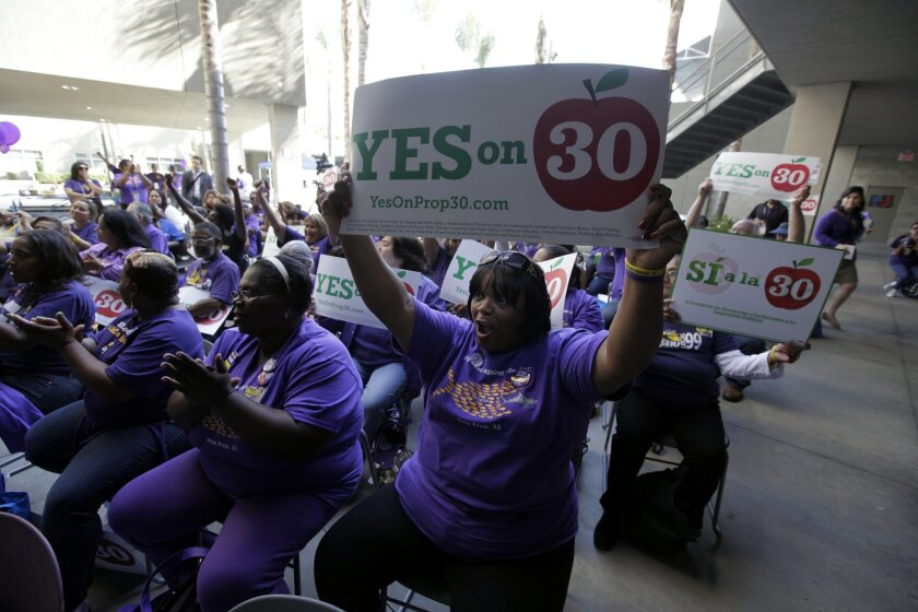 Service Employees International Union members worked hard for Gov. Jerry Brown's Proposition 30 tax increases last year, and invoked that support in negotiating for raises this year. (AP file photo/Reed Saxon)