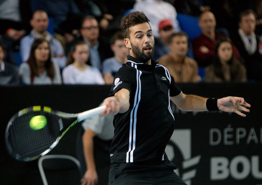 France's Benoit Paire returns the ball to Stanislas Wawrinka of Switzerland during their quarter final match, at the Open 13 Provence tennis tournament, in Marseille, southern France, Friday Feb. 19 , 2016. (AP Photo/Claude Paris)