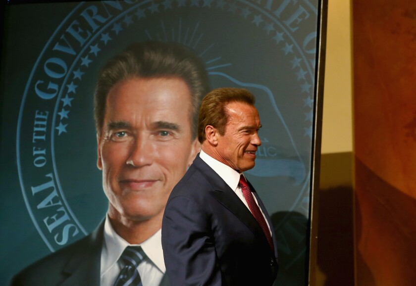 Former Calif. Gov. Arnold Schwarzenegger stands in front of his gubernatorial portrait at the unveiling in the Rotunda of the State Capitol in 2014.