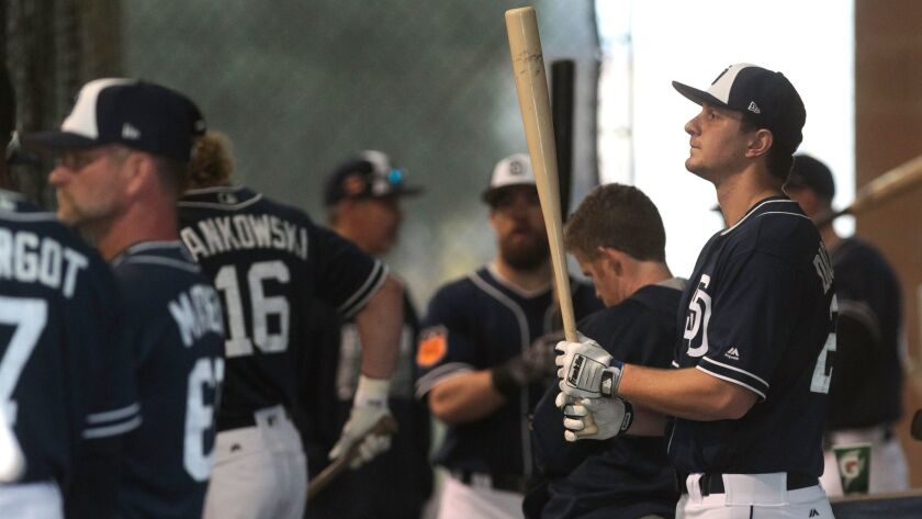 PEORIA , February 18, 2017 | The Padres' Alex Dickerson holds up his bat as he and other players bat in the batting cages at the Peoria Sports Complex in Peoria, Ariz. on Saturday, Feb. 18, 2017.