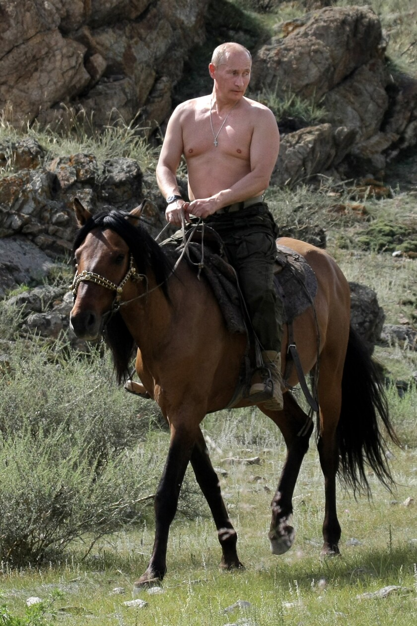 Russian Prime Minister Vladimir Putin rides a horse during his vacation outside the town of Kyzyl in the southern Siberia on Aug. 3, 2009.