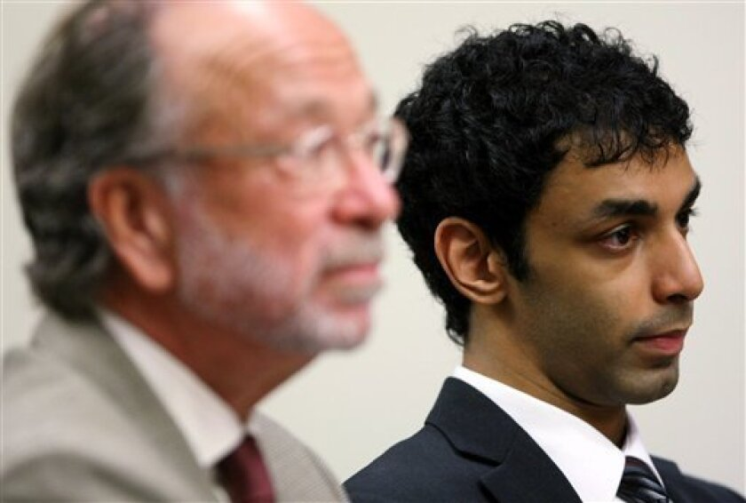 Former Rutgers student Dharun Ravi, right, Tyler Clementi's former roommate, and his attorney Steven Altman listen as Judge Glenn Beman, not seen, speaks at the Middlesex County Court in New Brunswick, during a motion hearing Friday, Sept. 9, 2011 in New Brunswick, N.J. Berman on Friday refused to dismiss hate crime, invasion of privacy and other charges against Ravi. He also says prosecutors must give defense lawyers the name of the man who was allegedly seen in a webcam video having an intimate encounter with Rutgers student Tyler Clementi. Clementi killed himself by jumping from the George Washington Bridge soon after the incident last September. (AP Photo/Mark R. Sullivan, Pool)