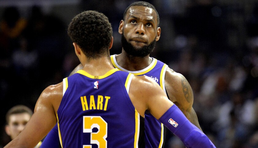 Los Angeles Lakers guard Josh Hart (3) and forward LeBron James (23) bump chests after Hart scored a