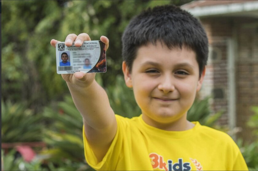 In this undated photo , Carlos Santamaria Diaz shows his university identification card, in Cuernavaca, Mexico. Mexico's National Autonomous University, or UNAM, says it has admitted the 12-year-old student to its undergraduate degree program in biomedical physics.