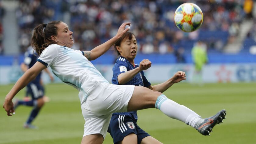 Argentina's Florencia Bonsegundo, left, and Japan's Hina Sugita challenge for the ball during a Women's World Cup Group D match Monday in Paris.