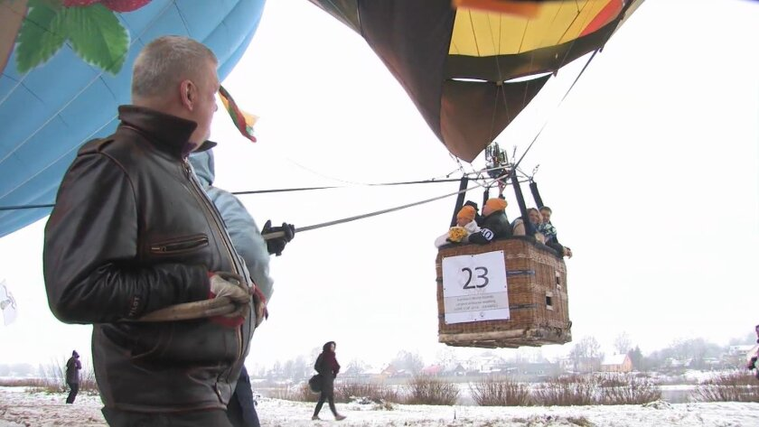 This image taken from Associated Press television shows ahot air balloon with couples about to be wed in Jekabpils, Latvia Sunday Feb. 14, 2016. Latvian couples tied the knot in the air on Valentine's Day hoping to set a world record in the number of simultaneous weddings in hot air balloons. Fifty
