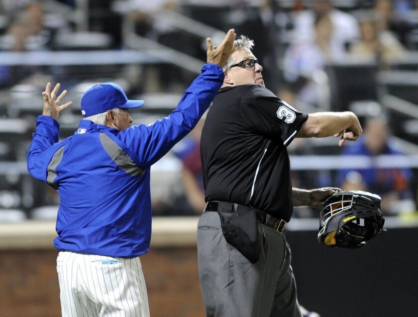 New York Mets manager Terry Collins, left, reacts as home plate umpire Gary Cederstrom, right, ejects him from during the fifth inning of a baseball game against the Milwaukee Brewers, Wednesday, June 11, 2014, at Citi Field in New York. (AP Photo/Bill Kostroun)