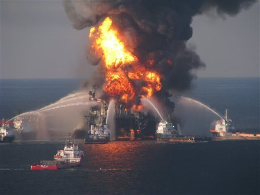 This image provided by the U.S. Coast Guard shows fire boat response crews battle the blazing remnants of the off shore oil rig Deepwater Horizon Wednesday April 21, 2010. The Coast Guard by sea and air planned to search overnight for 11 workers missing since a thunderous explosion rocked an oil drilling platform that continued to burn late Wednesday. (AP Photo/US Coast Guard)