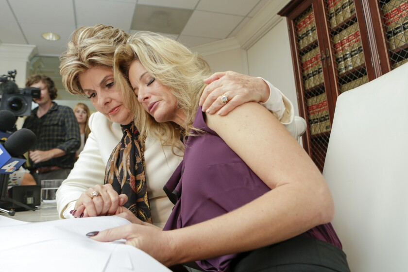 Gloria Allred, left, with Summer Zervos, who said that Trump kissed her on the lips several times when she went to his office in 2007.