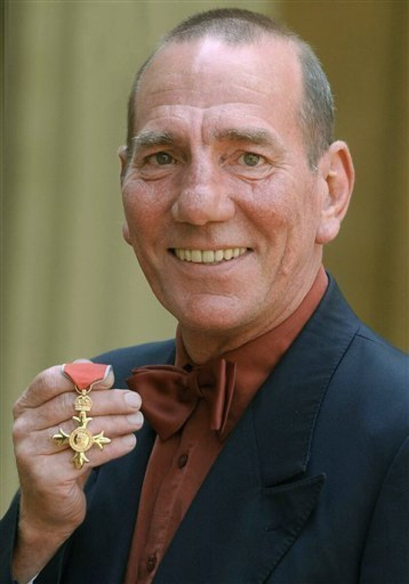 FILE -A Wednesday, June 9, 2004 photo from files showing British actor Peter Postlethwaite displaying his Order of the British Empire or OBE, shortly after the presentation at Buckingham Palace in London. Britain's Press Association is reporting Monday, Jan. 3, 2011 that decorated film actor Pete Postlethwaite has died at the age of 64. It quotes longtime friend Andrew Richardson as saying Monday that Postlethwaite died in hospital in Shropshire, central England, after a long illness. Richardson said Postlethwaite died Sunday. He had been receiving treatment for cancer. (AP Photo /Kirsty Wigglesworth/ Pool)