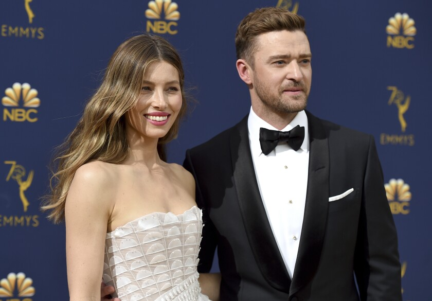 """FILE - In this Sept. 17, 2018 file photo Jessica Biel, left, and Justin Timberlake arrive at the 70th Primetime Emmy Awards in Los Angeles. Timberlake has publicly apologized to his actress-wife Jessie Biel weeks after he was seen holding hands with the co-star of his upcoming movie. The pop star and actor wrote on Instagram, Wednesday, Dec. 4, 2019, that he prefers to """"stay away from gossip as much as I can, but for my family I feel it is important to address recent rumors that are hurting the people I love."""" (Photo by Jordan Strauss/Invision/AP, File)"""