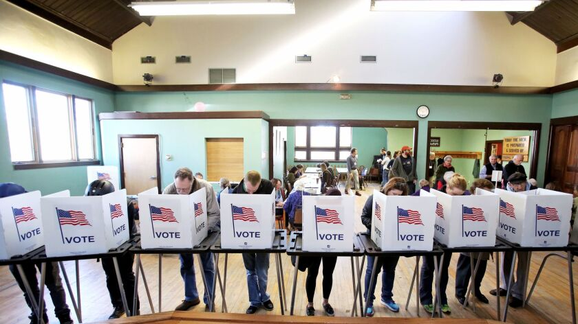 FILE - In this Tuesday, Nov. 8, 2016 file photo, voters cast their ballots at the Wil-Mar Neighborho