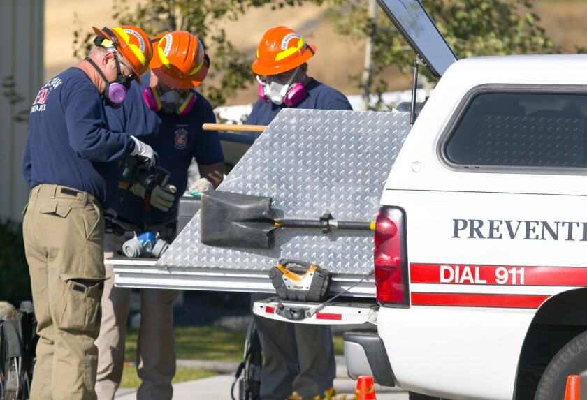 Investigators from the Pullman Fire Department work outside the Planned Parenthood building on Friday. Fire investigators ruled that an early-morning fire was an arson.