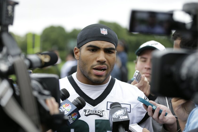 FILE - In this June 2, 2015, file photo, Philadelphia Eagles linebacker Mychal Kendricks speaks with members of the media after organized team activities at the team's NFL football training facility in Philadelphia. Kendricks, Kiko Alonso and DeMeco Ryans give the Eagles a formidable group of inside linebackers, though none of them have played yet this preseason. (AP Photo/Matt Rourke, File)