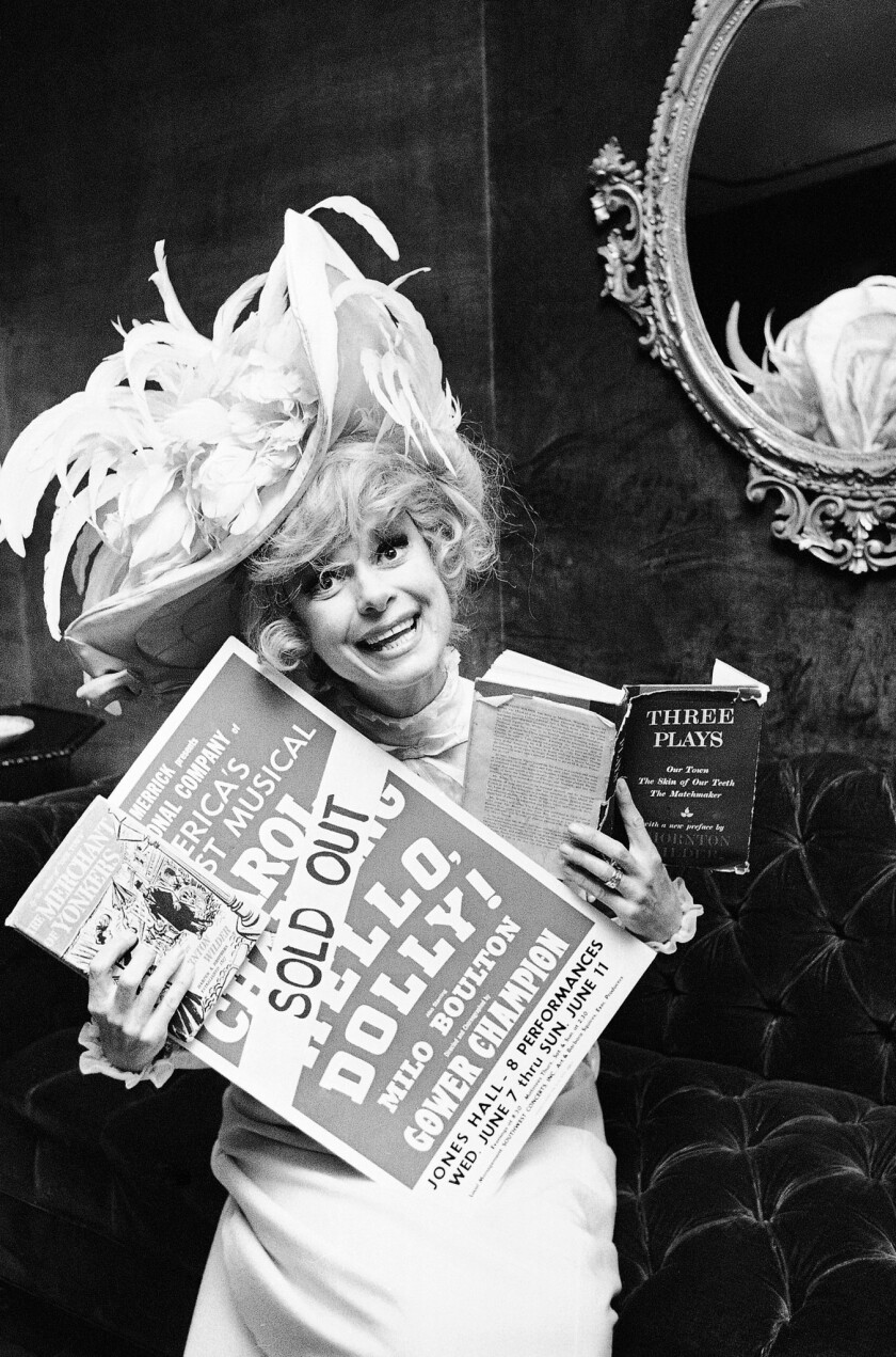 """FILE - In this June 11, 1967 file photo, Carol Channing holds a sold out advertisement poster of """"He"""