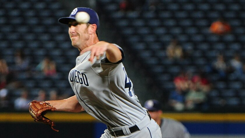 Padres reliever Tom Layne, who made his major league debut by striking out the side in Atlanta, thought about giving up the game before making the switch from starter to bullpen.