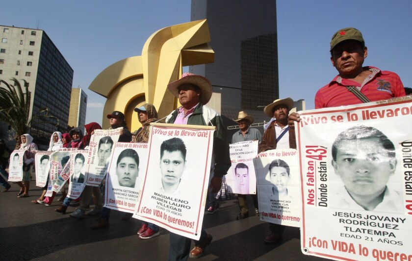 At a protest in Mexico City in February, parents of 43 college students who went missing in 2014 demand answers into their children's disappearance.