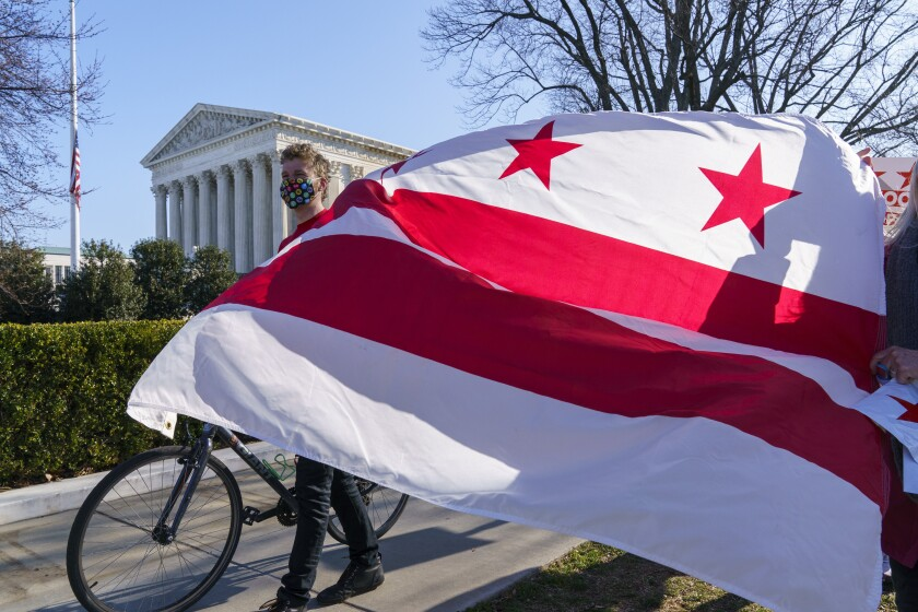 FILE - In this March 22, 2021, file photo advocates for statehood for the District of Columbia rally near the Supreme Court and Capitol prior to a House of Representatives hearing on creating a fifty-first state, in Washington. (AP Photo/J. Scott Applewhite, FIle)