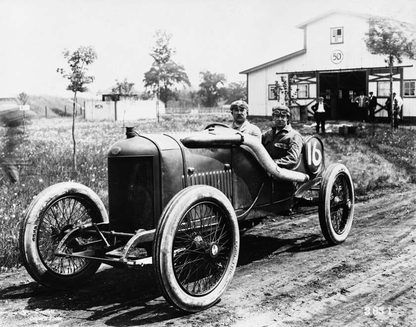 In this 1914 photo provided by Indianapolis Motor Speedway, driver Rene Thomas, left, and his riding mechanic, Robert Laly, are shown on a practice day before the fourth running of the Indianapolis 500 auto race at Indianapolis Speedway in Indianapolis, Ind. Europeans dominated the race for the sec