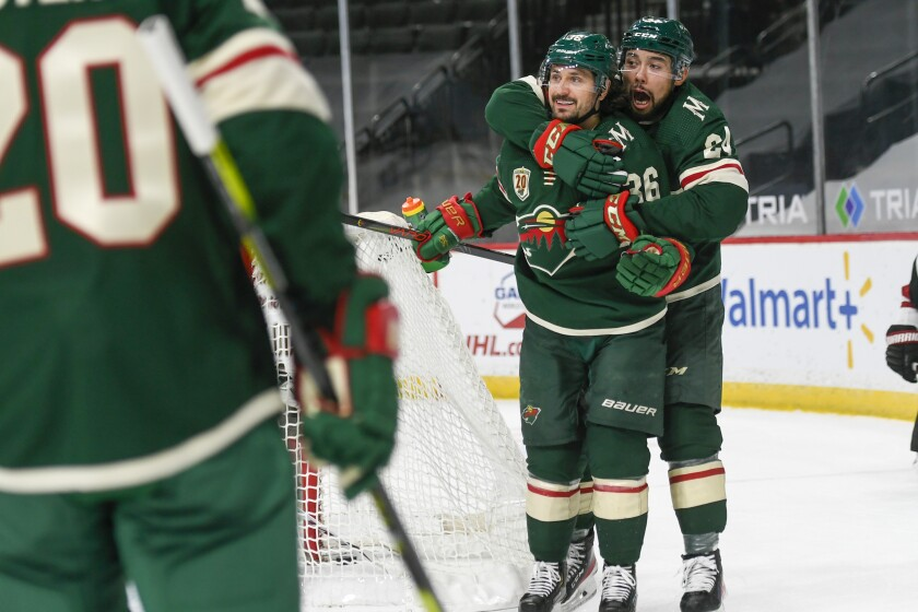 Minnesota Wild right wing Mats Zuccarello, second from right, celebrates with Wild defenseman Matt Dumba after Zuccarello scored a goal against the Arizona Coyotes during the first period of an NHL hockey game on Wednesday, April 14, 2021, in St. Paul, Minn. (AP Photo/Craig Lassig)
