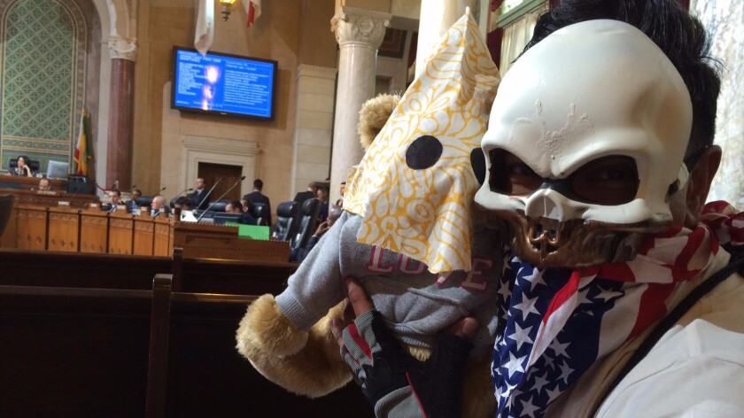 Armando Herman, seen Tuesday in the Los Angeles City Council chambers with his stuffed bear.