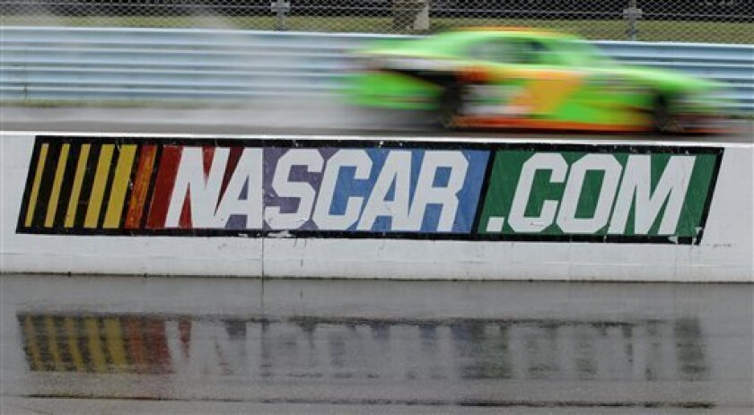 Danica Patrick practices for the NASCAR Nationwide Series auto race at Watkins Glen International in Watkins Glen, N.Y., Friday, Aug. 10, 2012. (AP Photo/David Duprey)