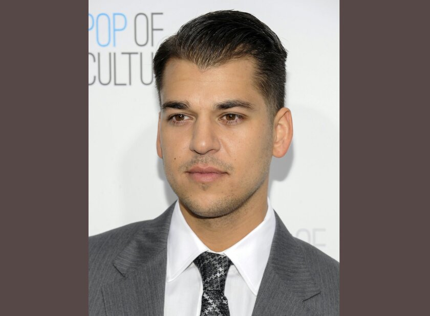 "FILE - In this April 30, 2012 file photo, Rob Kardashian from the show ""Keeping Up With The Kardashians"" attends an E! Network upfront in New York.  E! has greenlit a new reality series that will look inside the lives of Rob Kardashian and Blac Chyna on the heels of their engagement and pregnancy n"