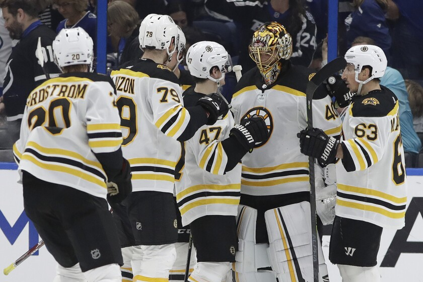 Boston Bruins players celebrate after a win.