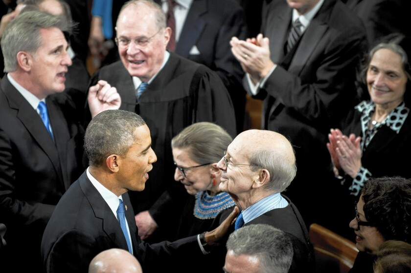 President Obama greets members of the Supreme Court before his State of the Union address.