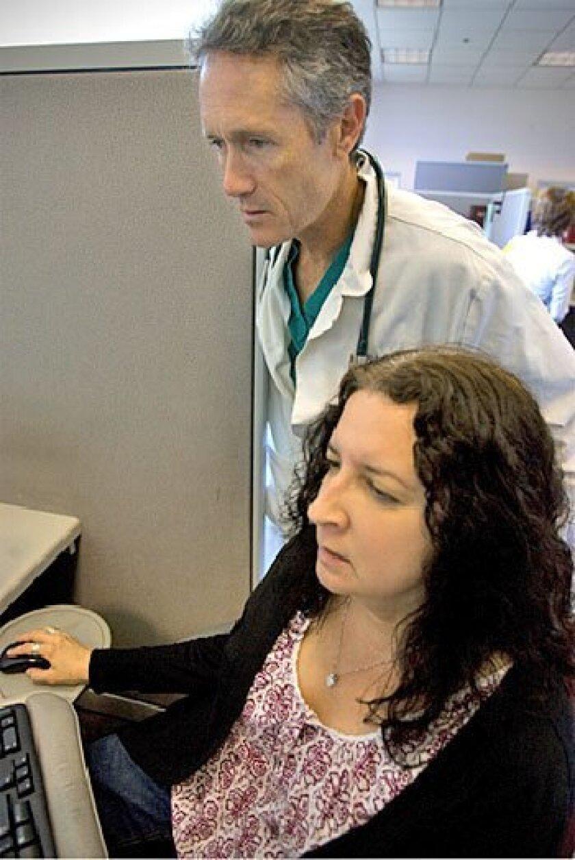 Dr. Rick Clark and pharmacist  Kathy Birnbaum, at UCSD  Medical Center.  (Nelvin C.  Cepeda / Union-Tribune)