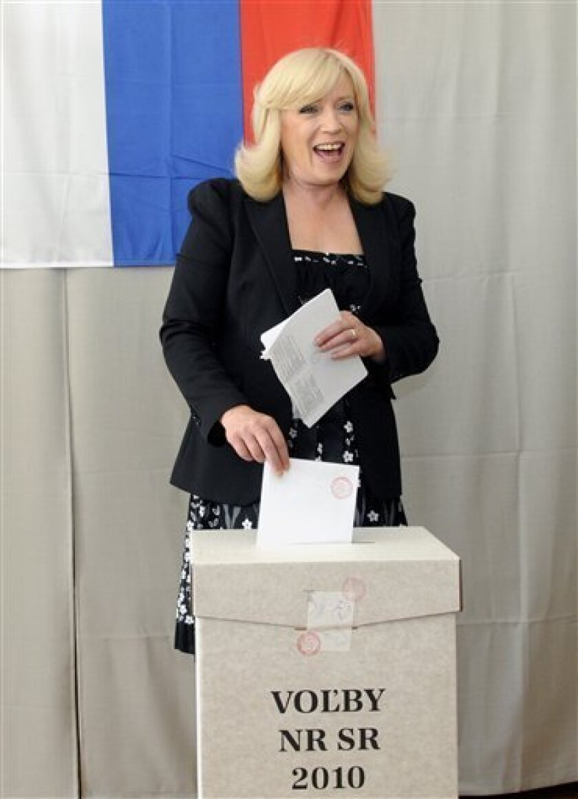 The strongest opposition party SDKU leader Iveta Radicova casts her ballot during the one-day parliamentary elections in the village of Nova Dedinka, near Bratislava, on Saturday, June 12, 2010. (AP Photo/CTK, Jan Koller)