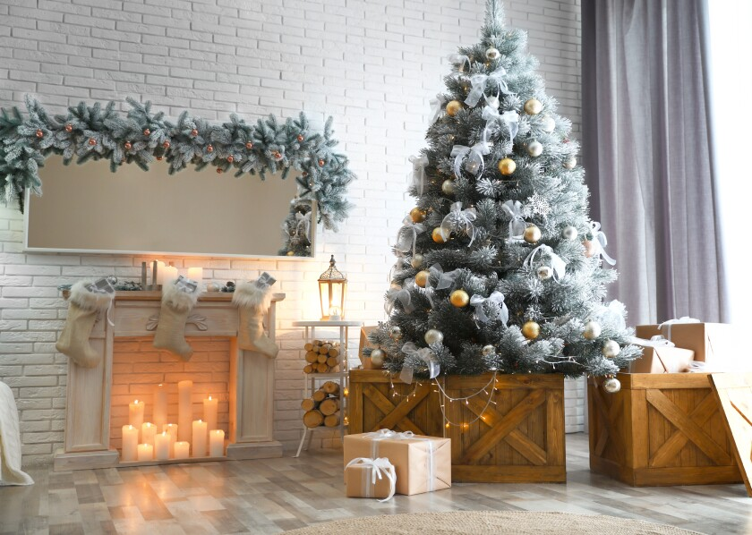 Stylish interior with decorated Christmas tree in living room
