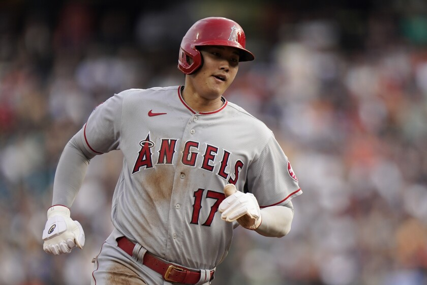Los Angeles Angels' Shohei Ohtani rounds third base on his way to score against the Detroit Tigers.