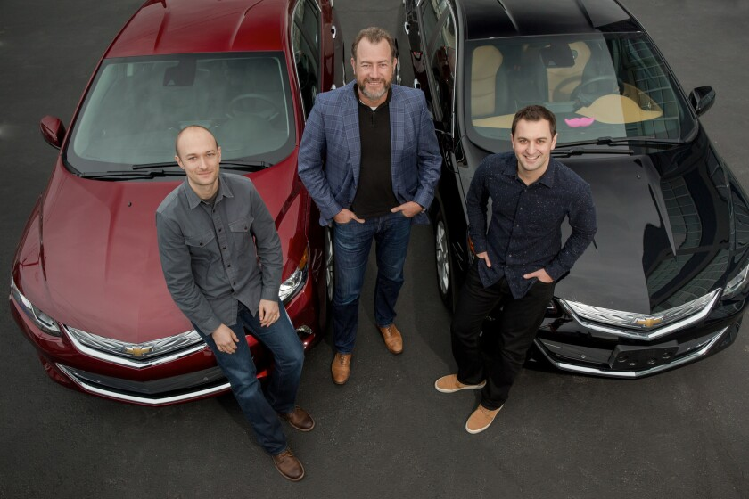 Lyft co-founder and Chief Executive Logan Green, left, GM President Dan Ammann, and Lyft co-founder and President John Zimmer.