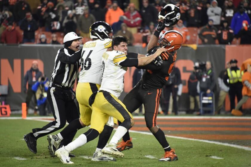 Cleveland Browns defensive end Myles Garrett swings a helmet at Pittsburgh Steelers quarterback Mason Rudolph on Nov. 14 at FirstEnergy Stadium.