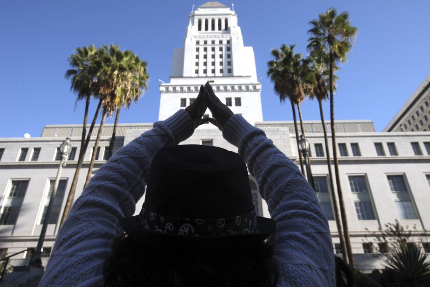 A community activist participates in a demonstration in front of L.A. City Hall over the lack of affordable housing.