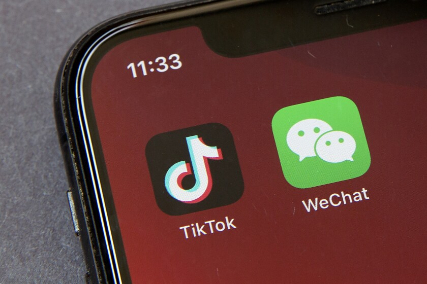 The TikTok and WeChat logos shown on a smartphone
