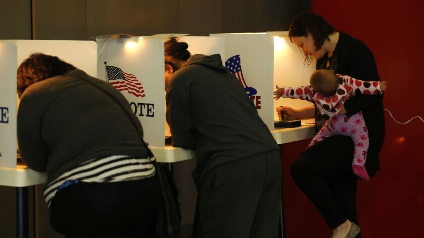 Voters cast ballots at the Mar Vista Fire Department in 2016.