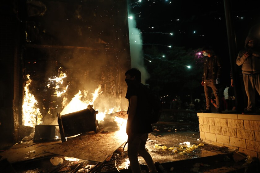 Protesters set fires at the 3rd Precinct of the Minneapolis Police Department on Thursday.