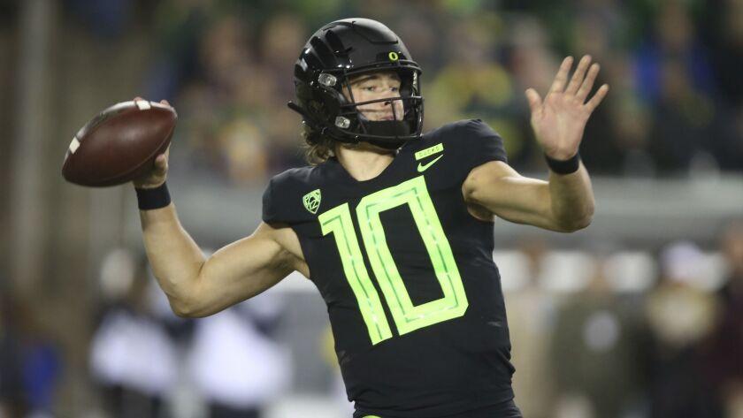 Oregon quarterback Justin Herbert readies to release a pass.
