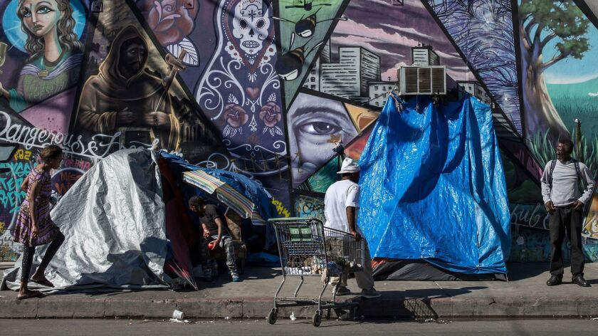 Homeless gather around tents along Stanford Ave. on Skid Row in Los Angeles on Nov. 8, 2016.