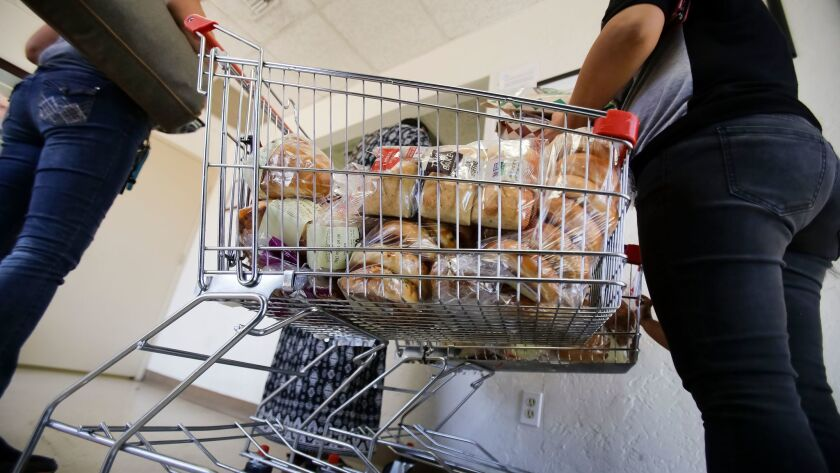 EL CAJON, CA: April 28, 2017 | A grocery cart filled with bread items is next to the check-in desk