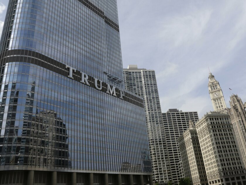 Newly installed 20-foot-tall letters spelling out T-R-U-M-P are seen on the side real estate billionaire Donald trump's skyscraper in Chicago, Thursday, June 12, 2014. The letters have triggered a war of words between Trump and Chicago Mayor Rahm Emanuel. (AP Photo/Stacy Thacker)