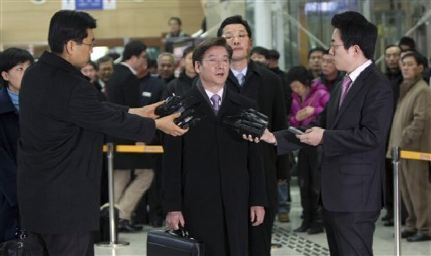 Kim Young-tak, head of a South Korean delegation, center, answers reporters' questions before leaving for North Korea's border city of Kaesong at the customs, immigration and quarantine, or CIQ office, near the border village of Panmunjom, in Paju, north of Seoul, South Korea, Monday, Feb. 1, 2010. A group of South Korean officials traveled Monday into North Korea for talks on a joint industrial complex despite renewed tension following the North's artillery firing toward their disputed sea border. (AP Photo/ Choi Woo-jung, Yonhap)