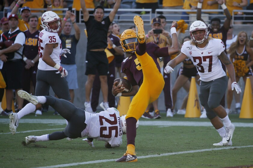 Arizona State quarterback Jayden Daniels flips into the end zone for a touchdown during the second half Saturday.