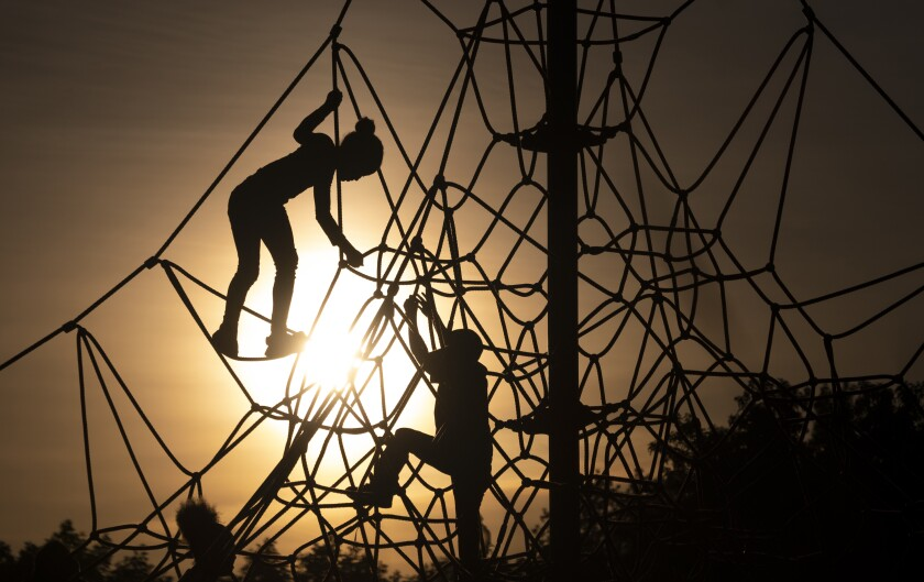 Children climb on play equipment during sunset in Liberty State Park on May 18, 2019 in Jersey City.
