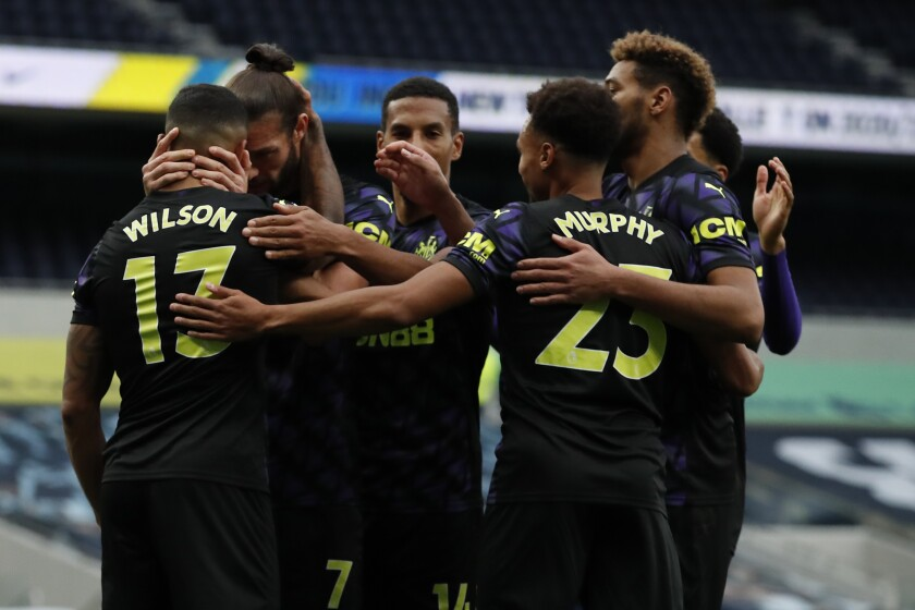 Newcastle's Callum Wilson, left, celebrates after scoring during the English Premier League soccer match between Tottenham and Newcastle at the Tottenham Hotspur Stadium in London, Sunday, Sept. 27, 2020. (Andrew Boyers/Pool via AP)