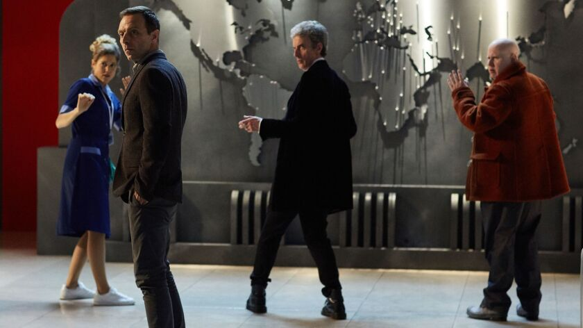 "Lucy (Charity Wakefiel), Dr. Sim (Aleksandar Jovanovic), the Doctor (Peter Capaldi) and Nardole (Matt Lucas) in a scene from ""The Return of Doctor Mysterioso,"" the 2016 ""Doctor Who"" Christmas episode."