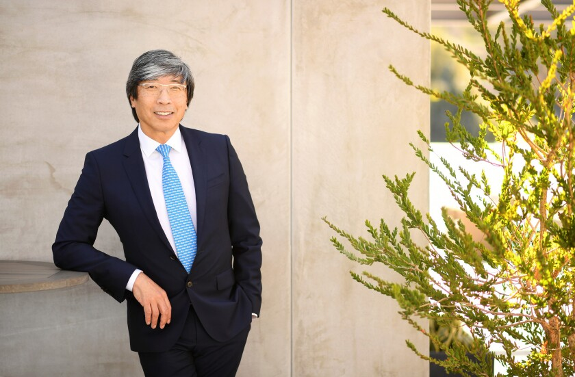 Dr. Patrick Soon-Shiong poses for a portrait in a suit outside his office building