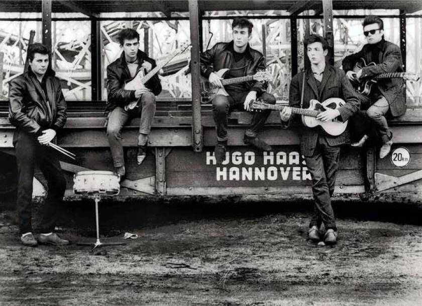 From left, Pete Best, George Harrison, John Lennon, Paul McCartney and Stuart Sutcliffe at Hugo Haase Fun Fair in 1960.